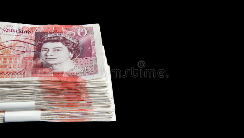 £50 notes. A stack of fifty pound notes making thousands of pounds royalty free stock photos