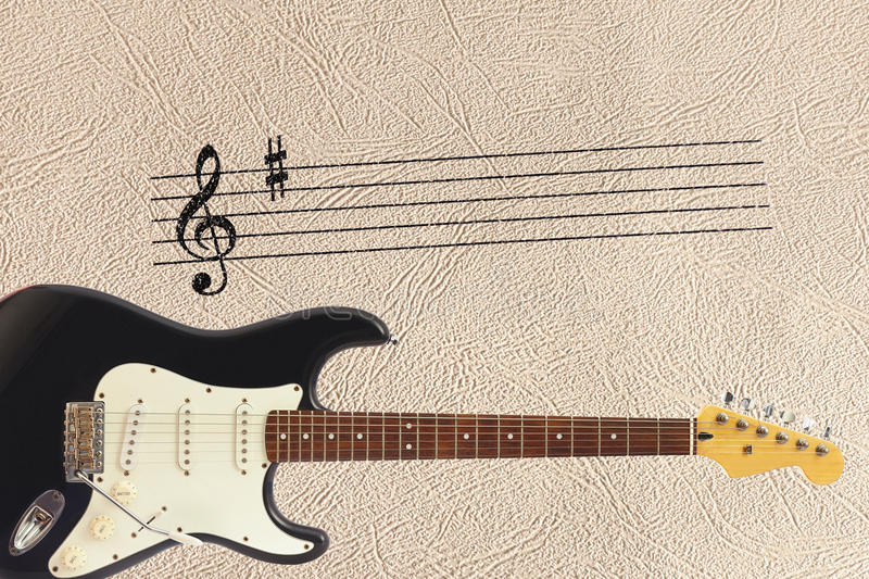 Notes stave and solid body classic electric guitar at bottom of the light skin background. Notes stave and solid body classic electric guitar at the bottom of royalty free stock images