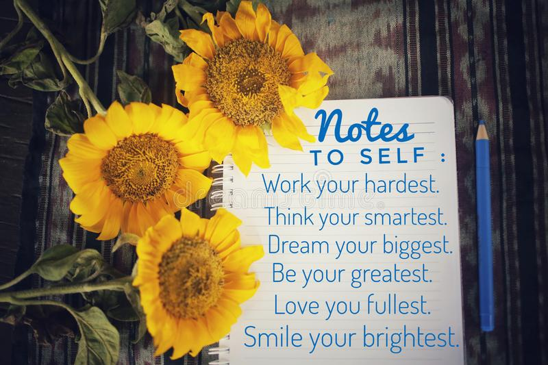 Notes to self on notebook white paper- Work your hardest, think smartest, dream  biggest, be your greatest, love you fullest stock photo