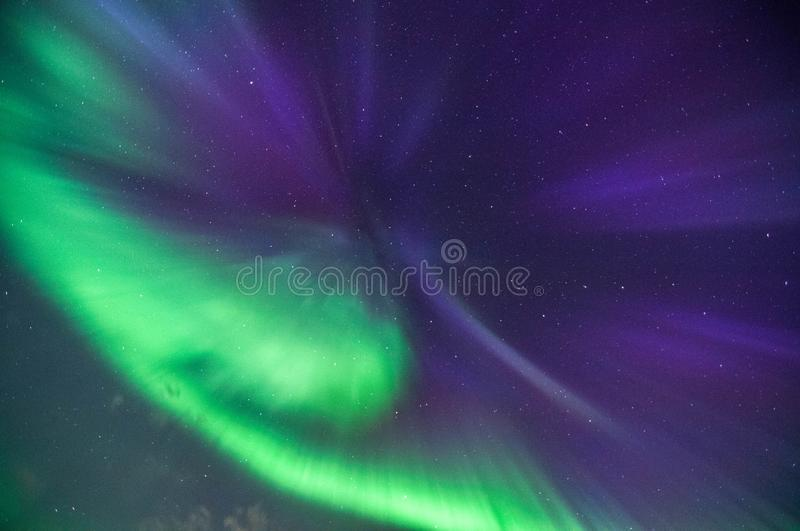 A nothern lights corona explodes over the night sky stock photography