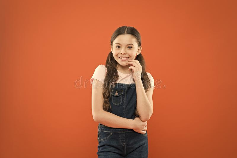 Nothing beats a great smile. Adorable little girl with big smile on orange background. Smiling child with white healthy. Smile on beautiful face. Cute small kid royalty free stock image