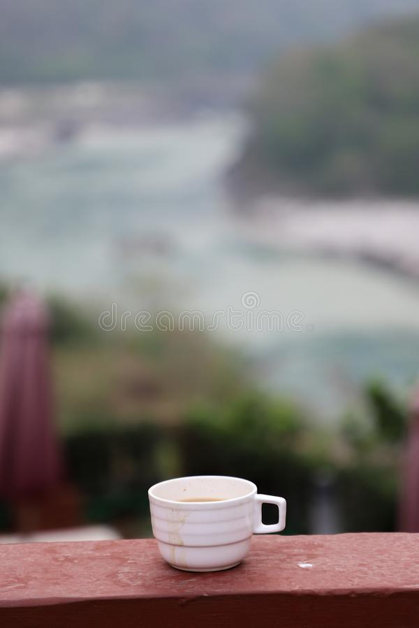 Hot cup of tea in a cloudy morning with the view royalty free stock photo