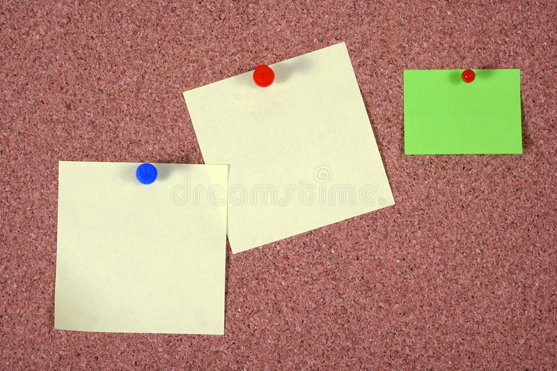 Notice board. With post-it notes and pins royalty free stock images