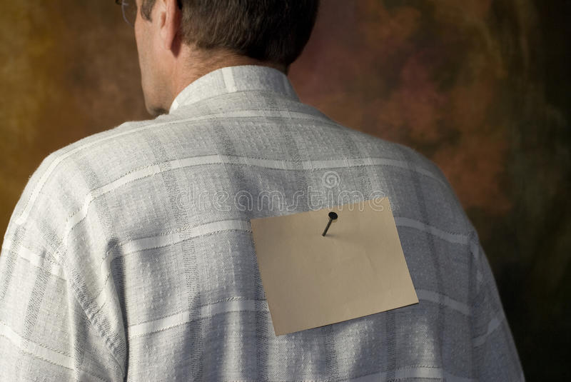 Download Notice Nailed To Man's Back Stock Photo - Image: 13779562