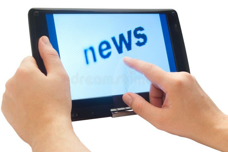 Noticias en la tablilla de tacto imagen de archivo libre de regalías