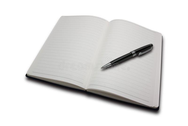Notitieboekje en een zwarte pen royalty-vrije stock foto's