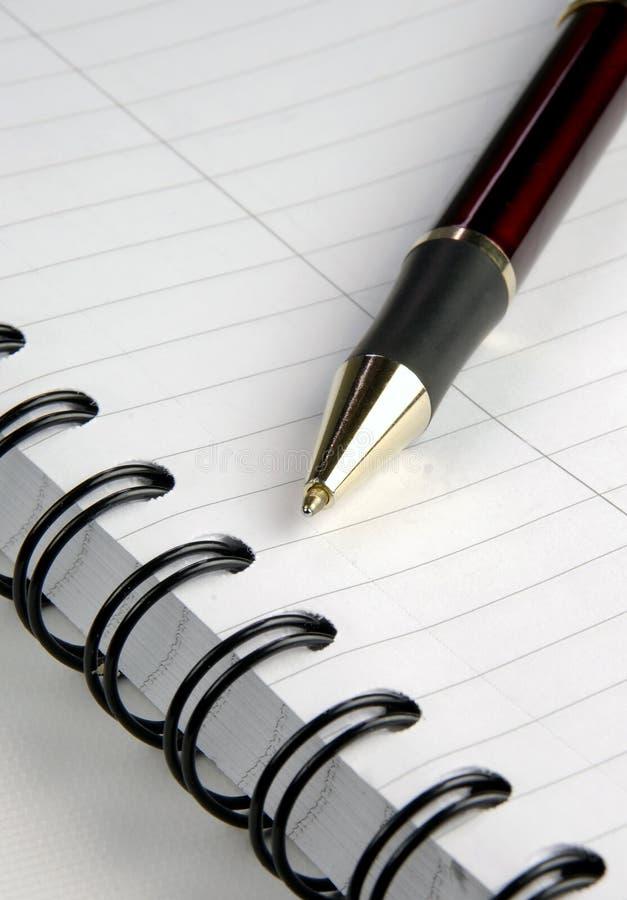 Notitieboekje en Pen stock foto's