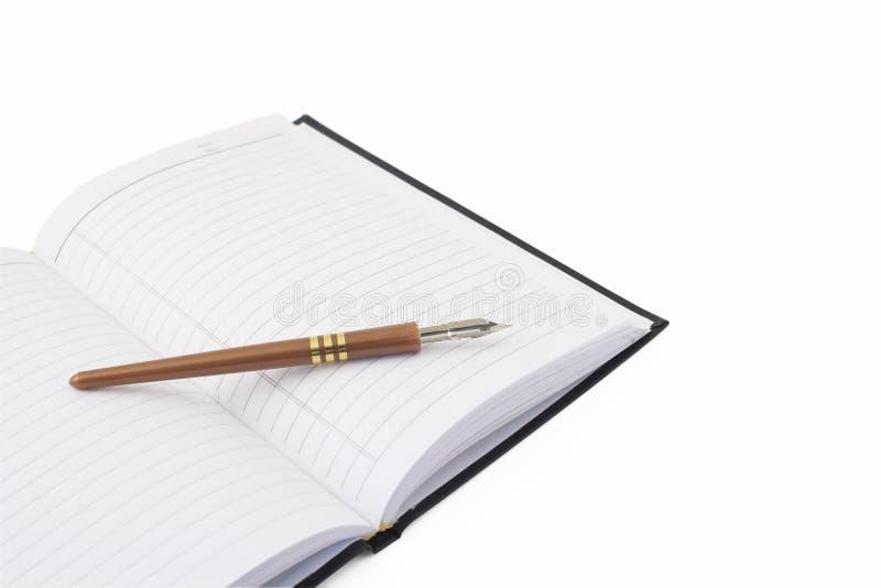 Notitieboekje en pen royalty-vrije stock afbeeldingen