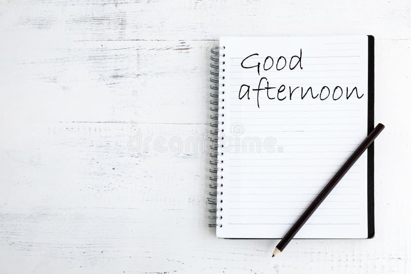 Notitieboekje met potlood op houten goosmiddag stock foto