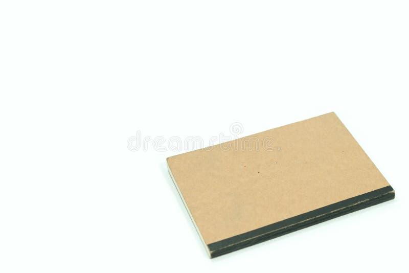 Notitieboekje op witte achtergrond wordt geïsoleerd die stock afbeeldingen