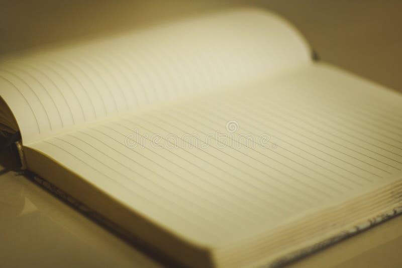 Notitieboekjeboek DA stock foto