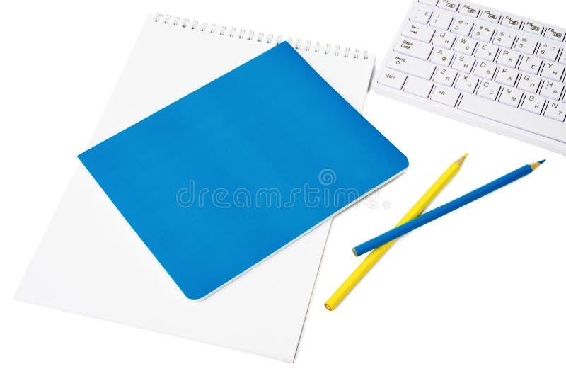 Notitieboekjes met toetsenbord royalty-vrije stock foto's
