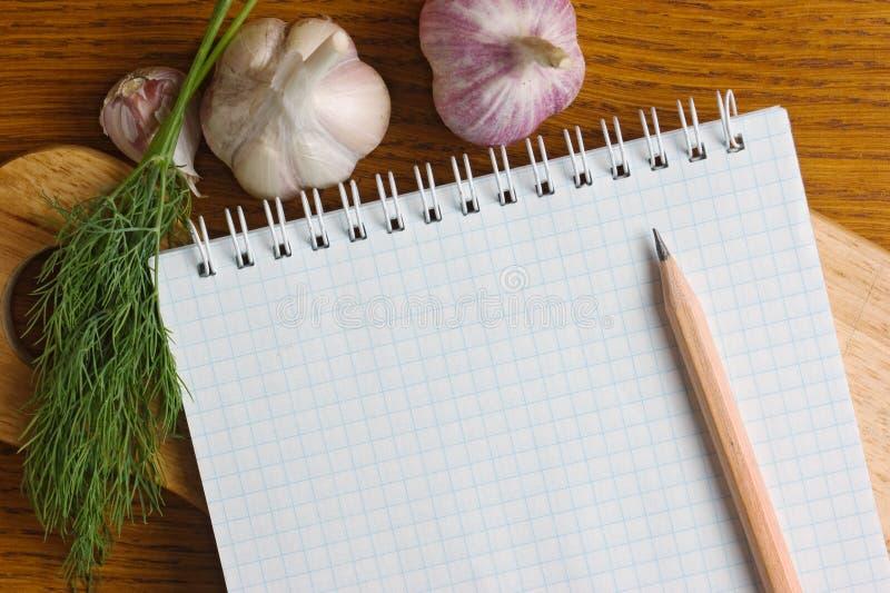 Notizbuch für das Kochen von Rezepten stockfotografie