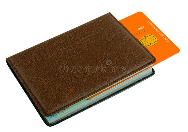 Notizbuch mit Kreditkartebookmark lizenzfreie stockbilder