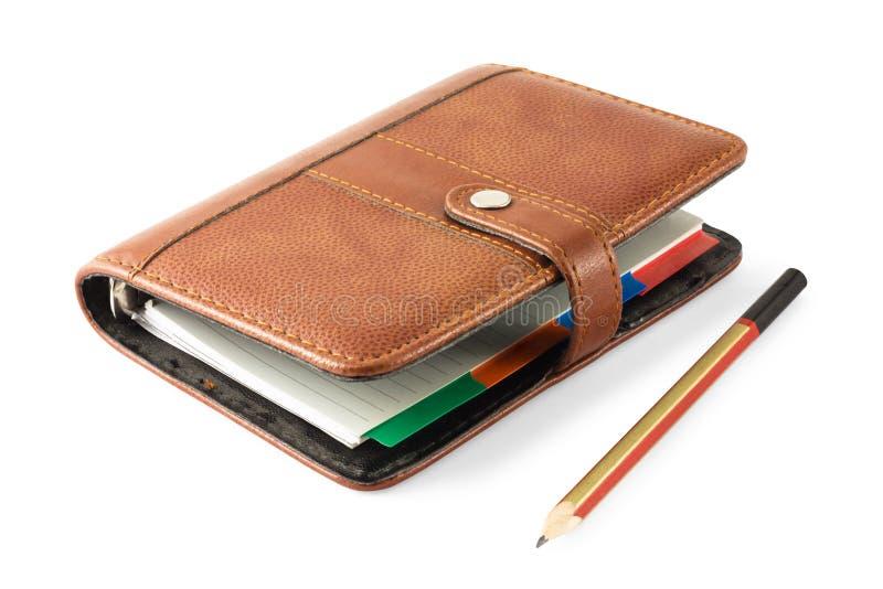 Notizbuch und Bleistift auf Weiß stockfotografie