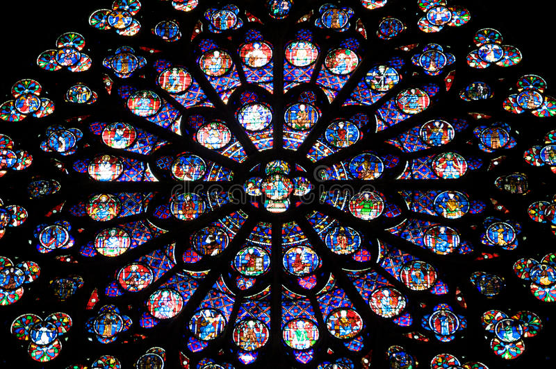 Notre dame. Stained glass window in Notre dame cathedral, Paris, France royalty free stock image