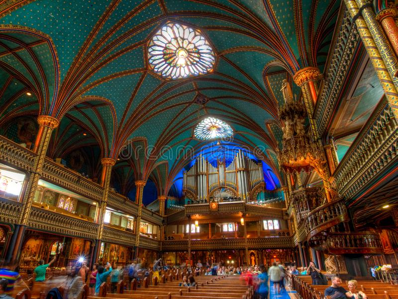 Notre Dame Basilica, interior, Montreal, QC, Canada. Interior photo of Notre Dame Basilica of Montreal, with its beautiful ceiling and circular stairway royalty free stock photos