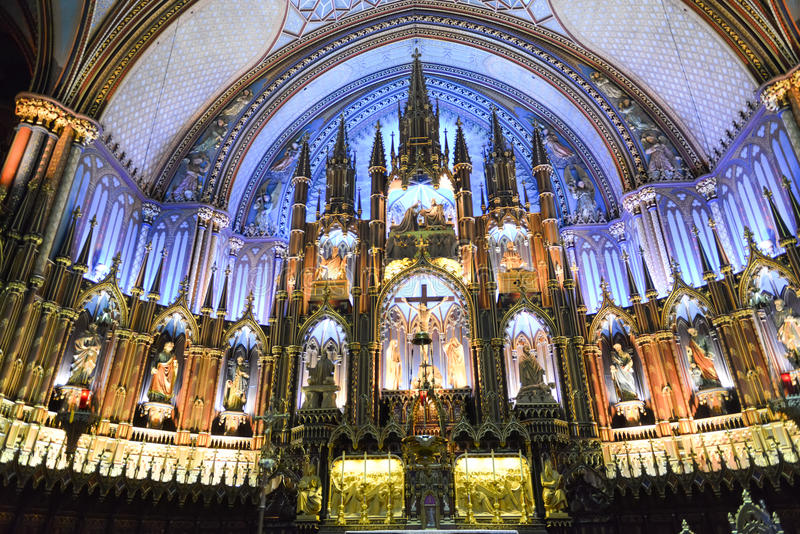 Notre Dame Basilica - Montreal, Canada. MONTREAL, CANADA - FEBRUARY 23, 2013: Interior of Notre-Dame basilica cathedral and its altar in Montreal, Canada. The royalty free stock photo