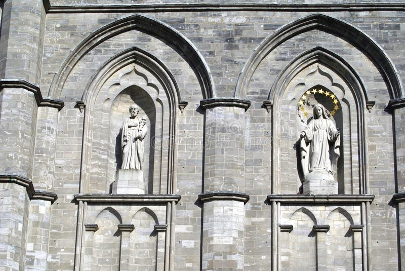 Notre Dame Basilica, Montreal, Quebec, Canada. Statues in alcove. The facade of the landmark Norte Dame Basilica in Canada royalty free stock images