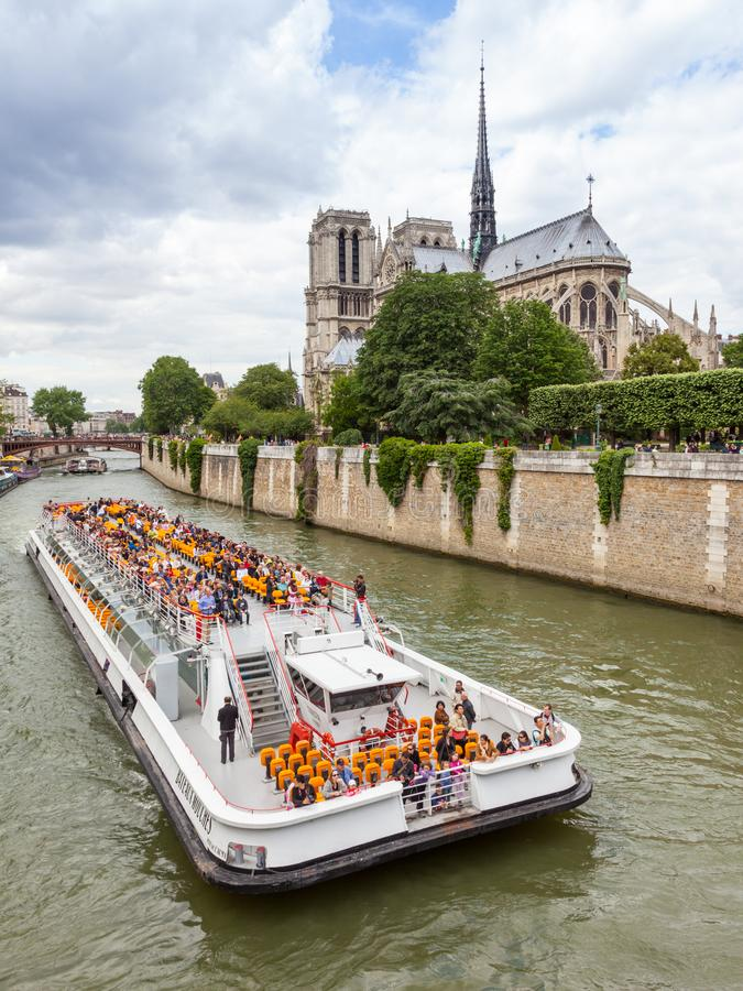 Notre Dame Cathedral and a Cruise Boat stock photo
