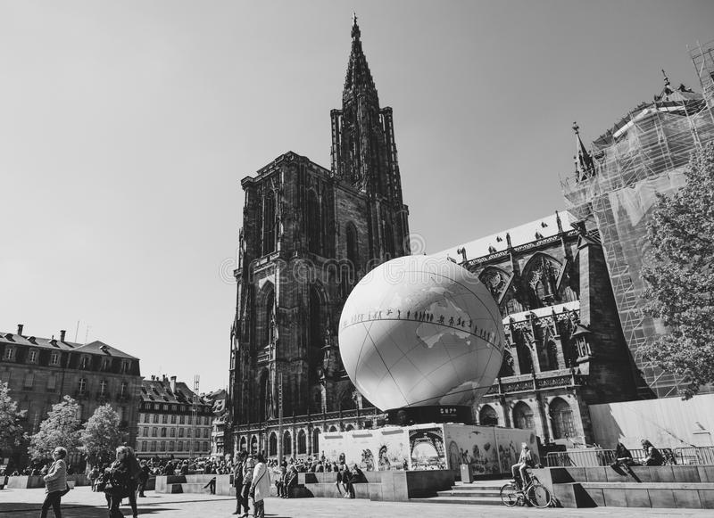 Notre-Dame cathedral and France Candidacy pavillion for World Fa. STRASBOURG, FRANCE - MAY 4, 2016: Cathedral Notre-Dame and urban pavilion in central square royalty free stock photo