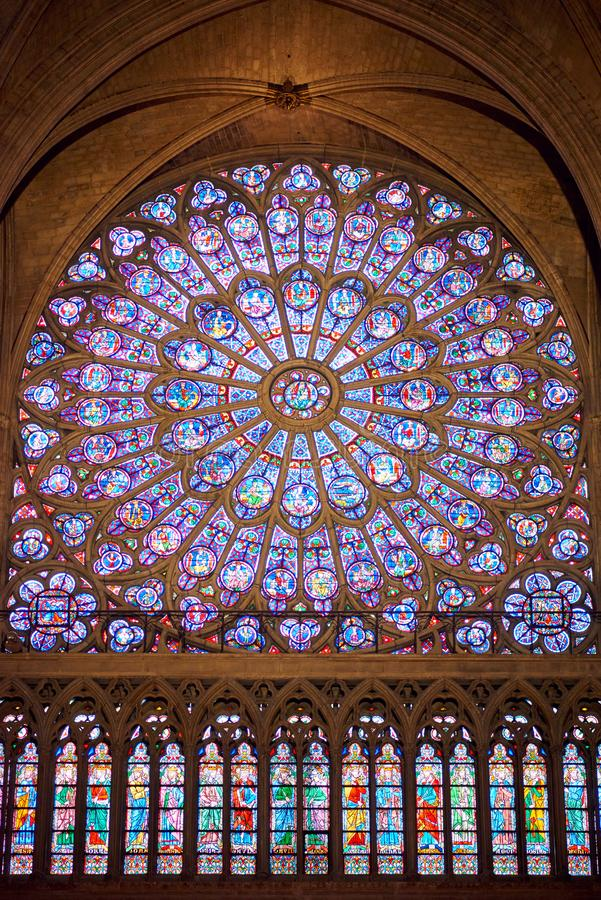 Notre Dame interior with stained glass. Notre Dame Cathedral interior with stained glass. Paris, France stock photo
