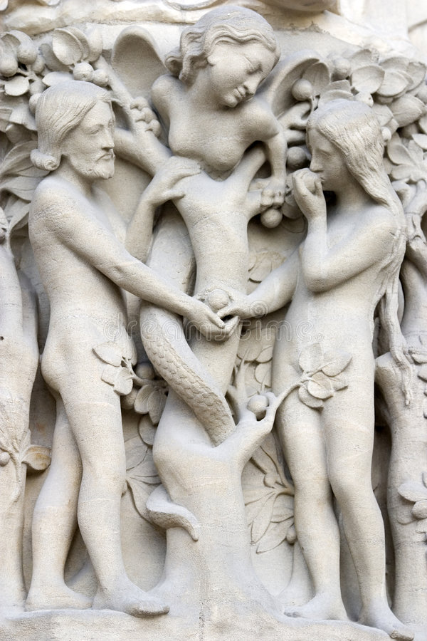Notre dame cathedral main entrance, detailed view of Adam and Eve scene royalty free stock photo