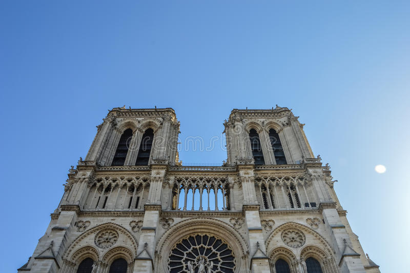 Notre Dame cathedral next to the river of Paris with boats and buildings summertime royalty free stock images