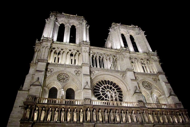 Notre Dame cathedral in Paris illuminated at night. Notre Dame de Paris cathedral in Paris, capital of France. View of Notre Dame illuminated at night royalty free stock photography