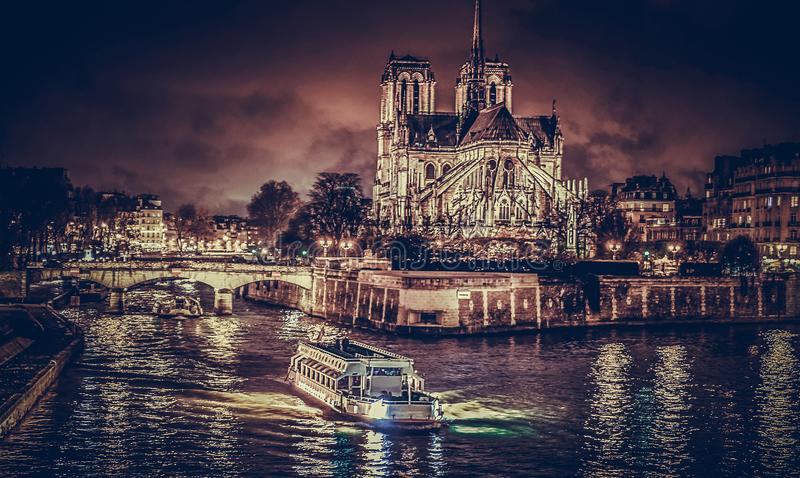 Notre Dame cathedral and river at night royalty free stock photo