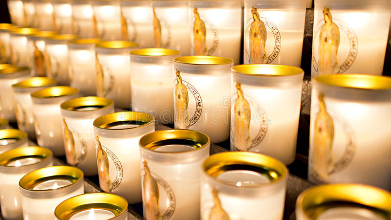 Notre Dame Cathedral votive candles. A close up photo of the votive/prayer candles taken at the Notre Dame Cathedral in Paris, France. A votive or prayer candle royalty free stock photo