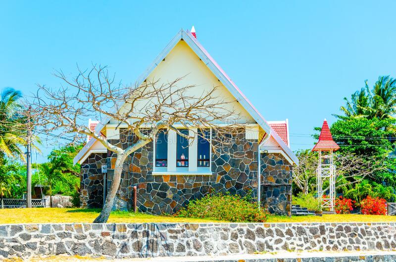 Notre Dame de Auxiliatrice - rural church with red roof in Cap Malheureux tropical village on Mauritius island, Indian stock photos