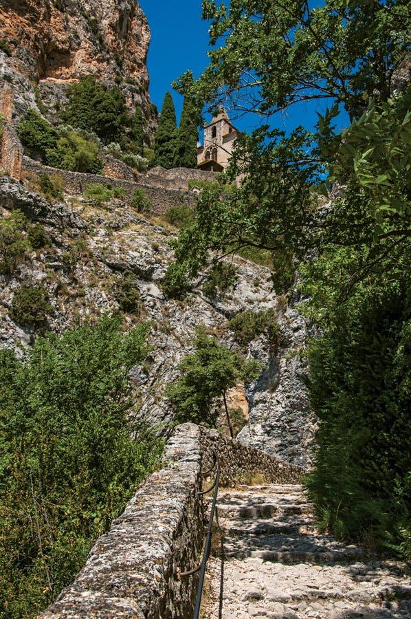 The Notre-Dame de Beauvoir church amidst cliffs and rocky pathway stock photos