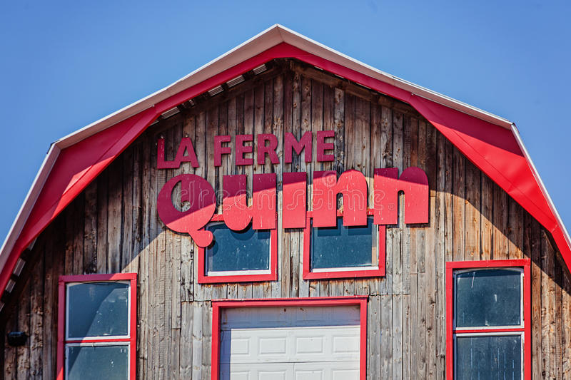 Notre-Dame-de-l`Ile-Perrot, Greater Montreal area, Quebec, Canada - March 27, 2016: Quinn farm on sunny Easter day. Barns roof royalty free stock photo