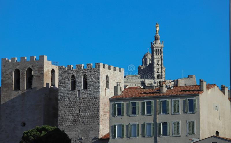 Notre-Dame de la Garde cathedral and Abbey of Saint Victor towers in Marseille - France stock photo