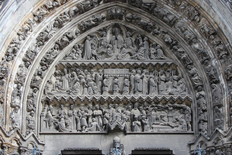 Notre-Dame-de-la-Treille - Lille - France. A sculpted tympanum decorates the gate of the Notre-Dame-de-la-Treille cathedral in Lille (France). Un tympan sculpt royalty free stock photography