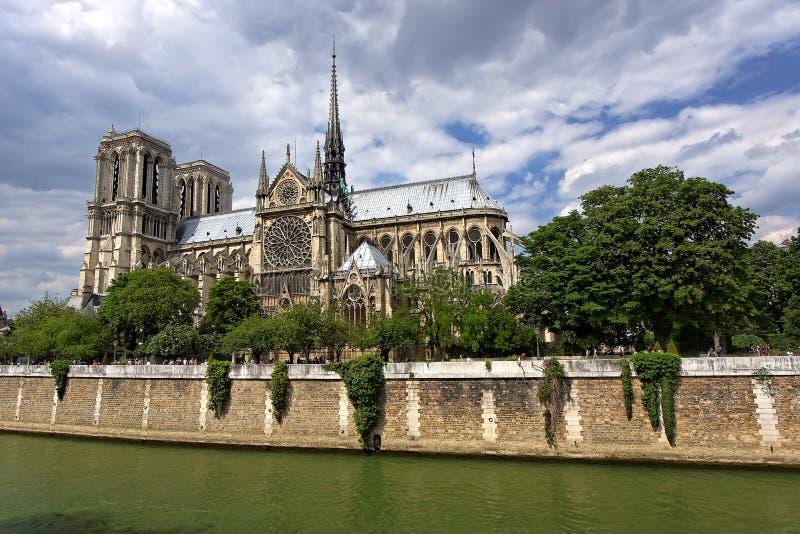 Download Notre Dame de Paris stock image. Image of green, clouds - 8387563