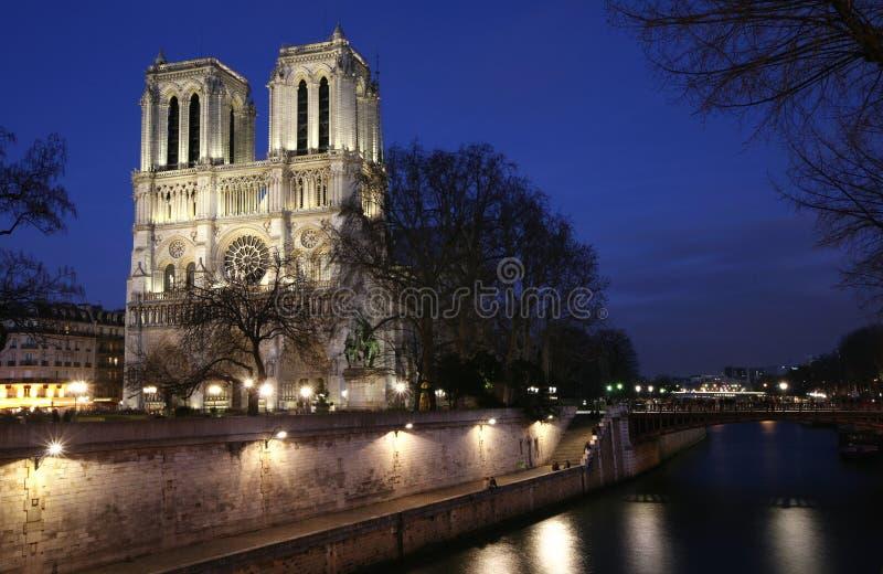Notre Dame de Paris by night. Notre Dame de Paris, with lights during winter on the blue hour royalty free stock images