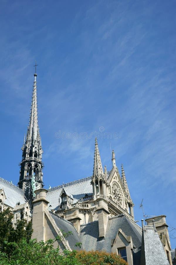 Notre-Dame de Paris Spire Rose window South view. Detail of the upper part of the Notre-Dame de Paris cathedral. Roofs and spires on a blue sky background. Paris stock images