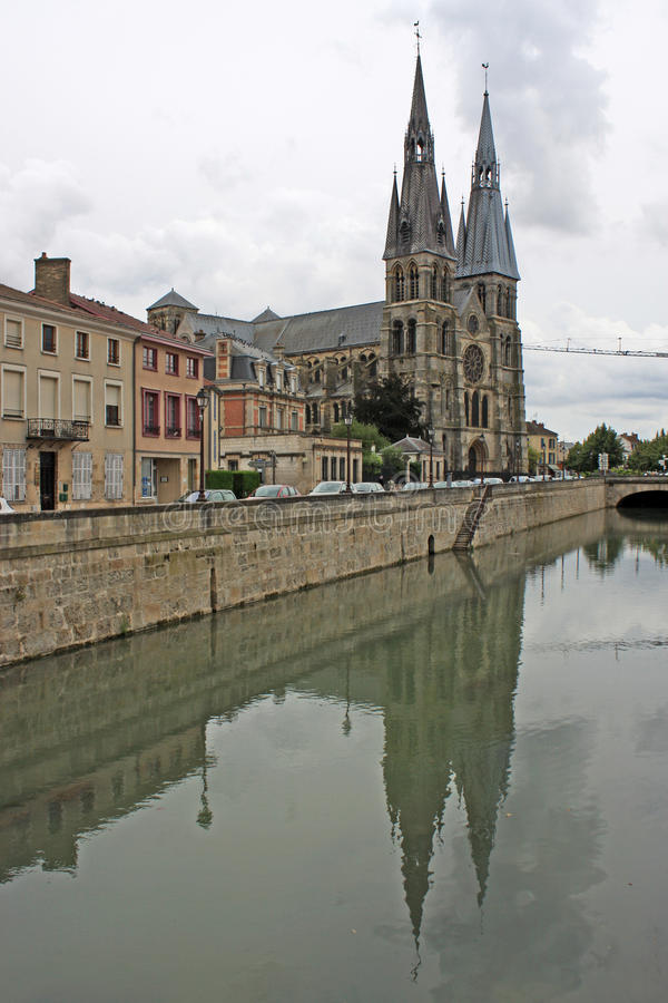 Notre-Dame-en-Vaux church, Chalons-en-Champagne, France. Canal by Notre-Dame-en-Vaux church, Chalons-en-Champagne, France royalty free stock images