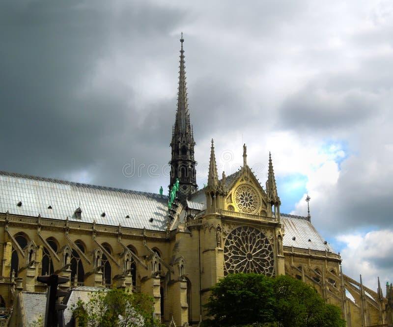 Notre Dame before fire destruction. Storm clouds stock image