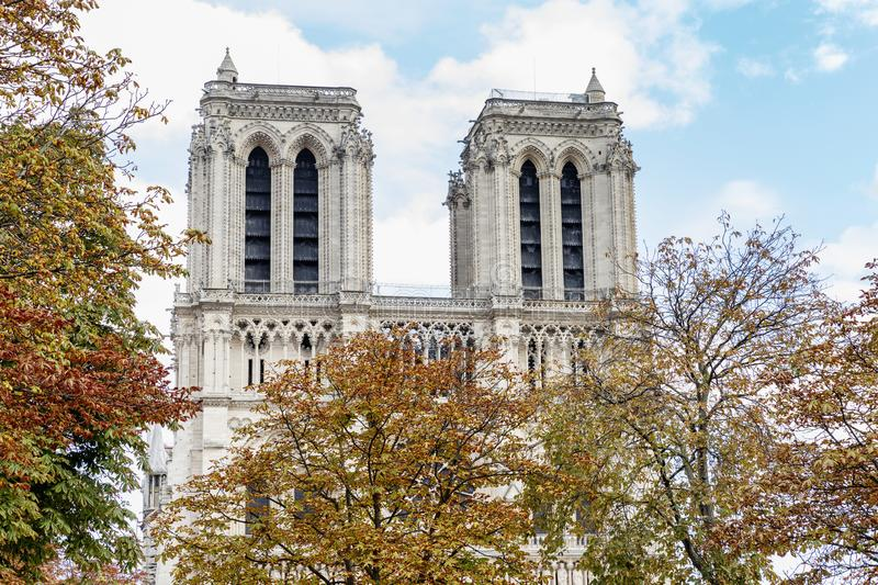 Notre Dame in Paris after a fire in the autumn foliage of trees. Beautiful city landscape. Space for text. Postcard stock photo