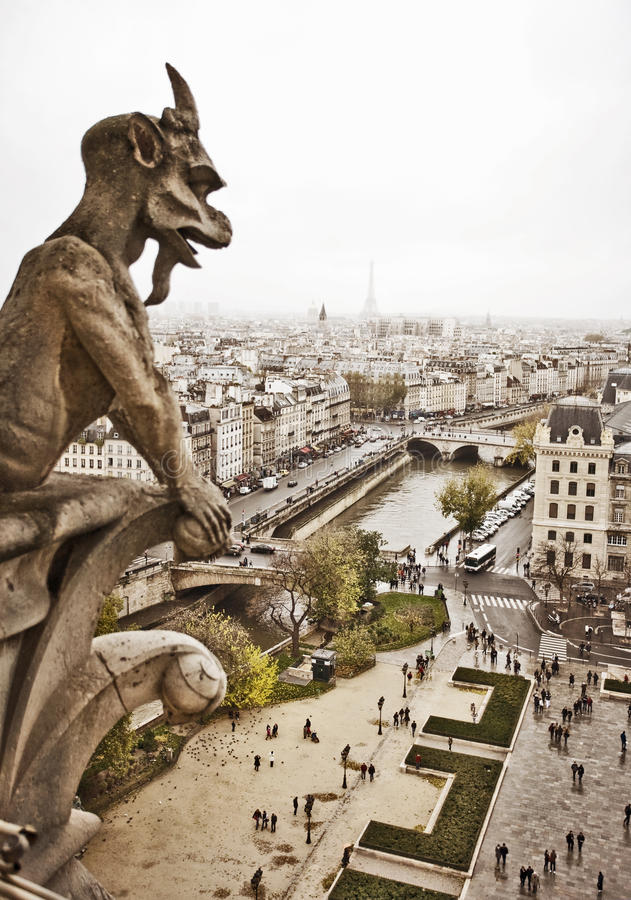 Notre Dame of Paris Gargoyle. Notre Dame of Paris. Gargoyle, one of the most famous Chimeras with the Paris skyline in the background stock photography
