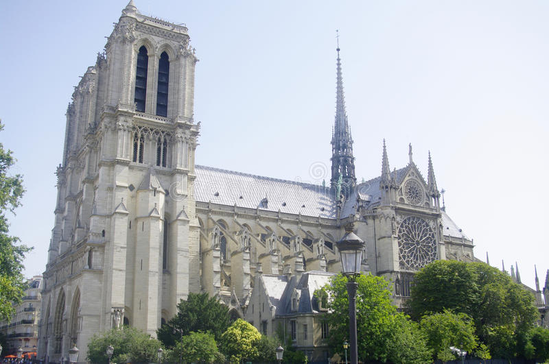 « Notre Dame » in Paris. It is located on the eastern half of the Île de la Cité in the fourth arrondissement of Paris. Its western facade dominates royalty free stock photo