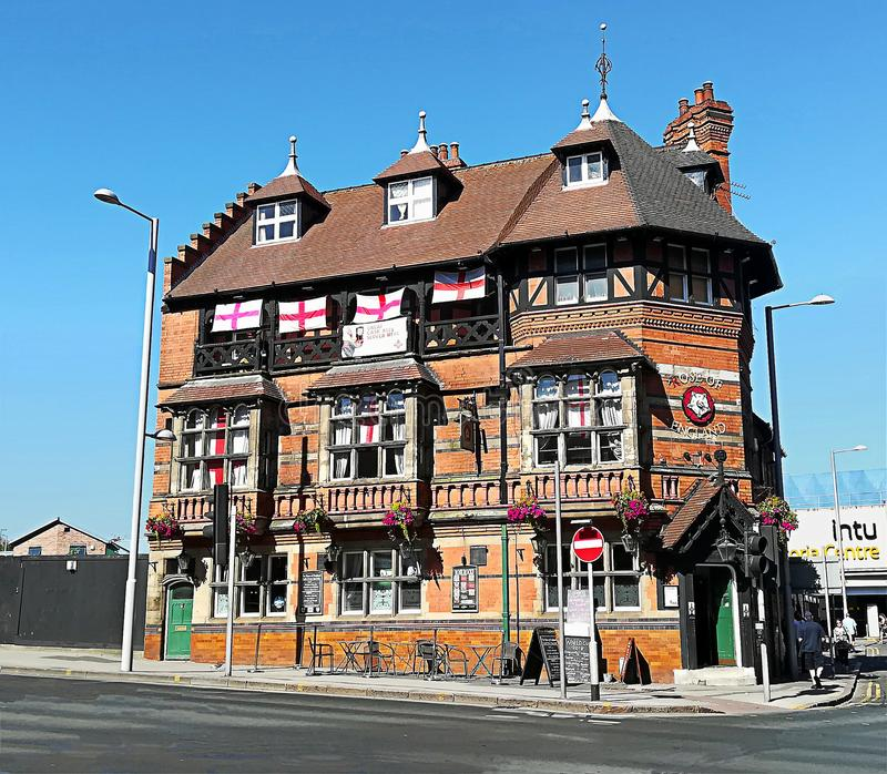 Nottingham, England, nice building in Mansfield Rd. Nottingham, England - June 25, 2018: nice red-brick building in Mansfield Rd, near Trent University. You can stock photos