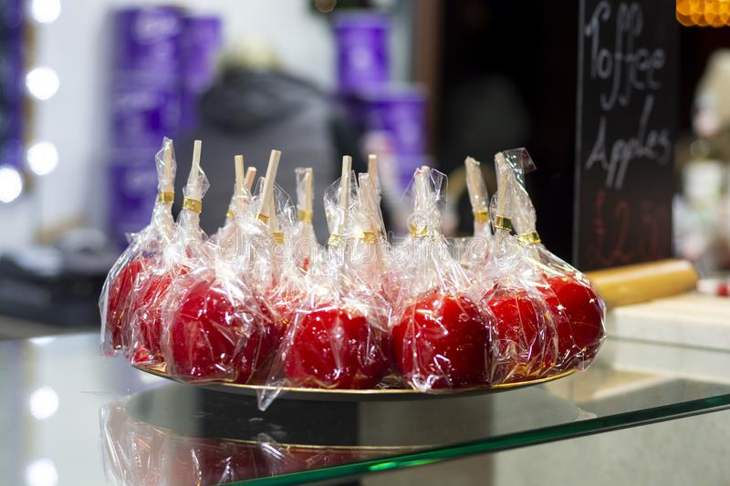 Nottingham, United Kingdom - December 14, 2019 - red winter apple snack at Christmas market. Nottingham, United Kingdom - December 14, 2019 - delicious red stock images