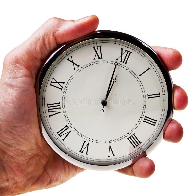 Notulen aan middernacht of middag op retro horloge. royalty-vrije stock afbeeldingen
