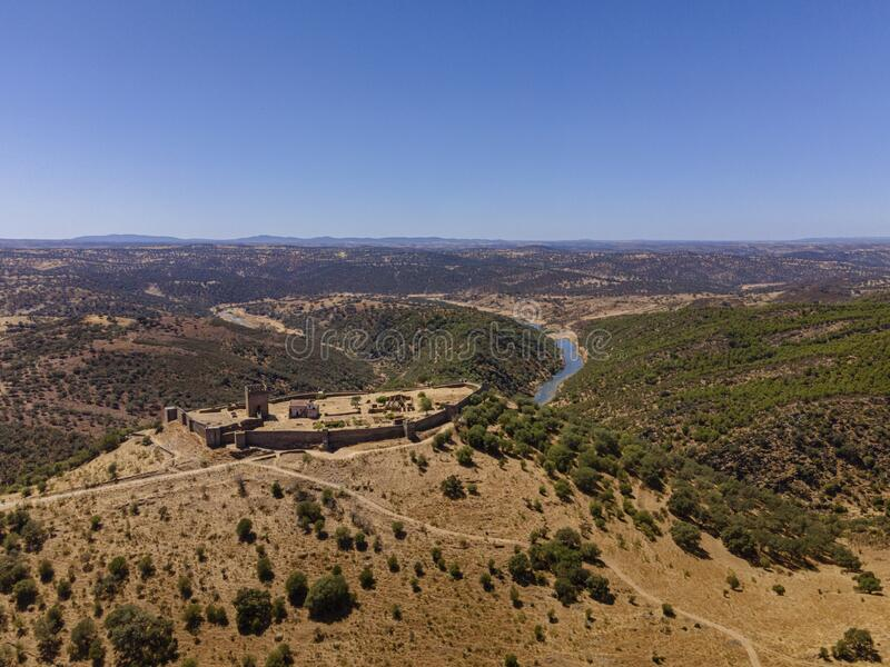 Noudar medieval castle aerial view, with Alentejo landscape background. Located 5 kilometres from the Spanish border. Alentejo,. Portugal stock photography