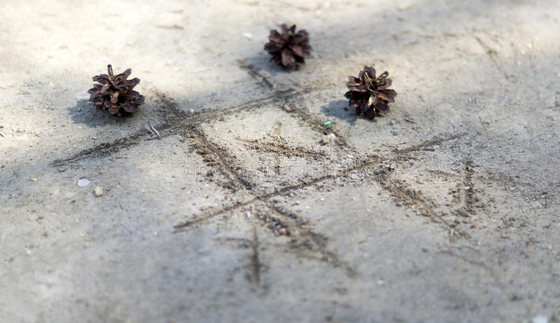 Noughts and crosses on the sand stock photos