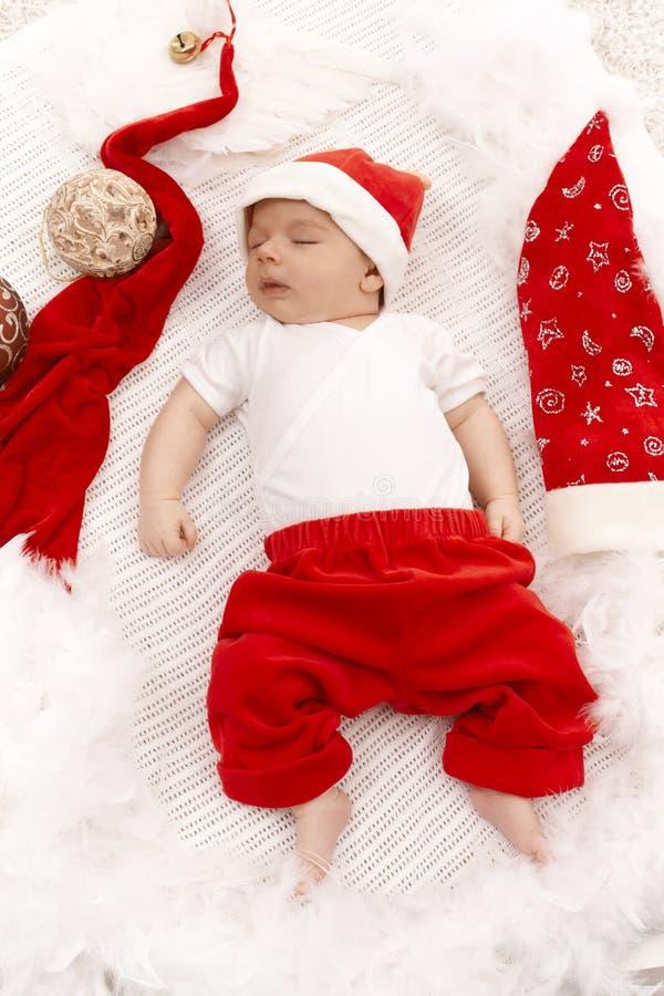 Nourrisson dans le chapeau de Santa images stock